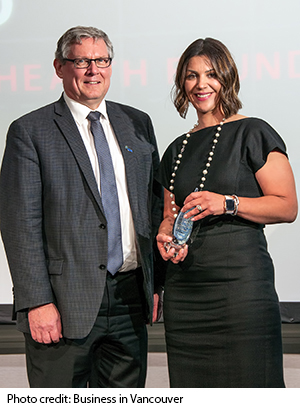Gina-accepting-award